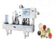 Máy tạo hình, chiết và dán nắp cốc sữa chua tự động